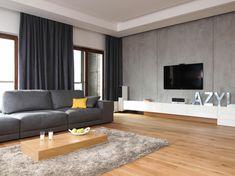 Minimalistische Fernsehwand Gestaltung mit weißen Lowboard und Beton-Wand Mehr