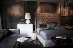 Luxe: Smith Boyd Interiors. Tufted headboard, wood grain wallpaper spudnick fixture. Details details!!