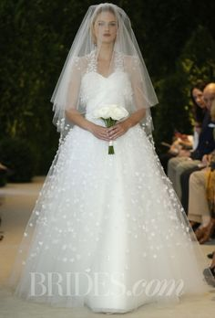 "Brides.com: Carolina Herrera - Spring 2014. ""Patricia"" ivory tulle with flower embroidery strapless gown with matching bolero and veil, Carolina Herrera"