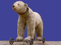 *STEIFF ~ bear on wheels