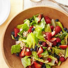 This Triple-Berry Salad is topped with a deliciously creamy coconut salad dressing. More blueberry recipes: http://www.bhg.com/recipes/healthy/healthy-blueberry-recipes/?socsrc=bhgpin080913berrysalad=13