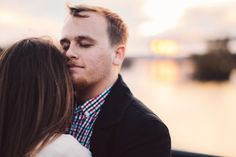 Fall Engagement Shoot in Downtown Richmond, VA - Belle Isle, Brown's Island. Sunset over James River. Groom soaking in his fiance's embrace. (www.commonsparkmedia.com)