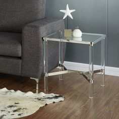 With A Combination Of Metal, Glass, And Acrylic Materials, This Table Has A