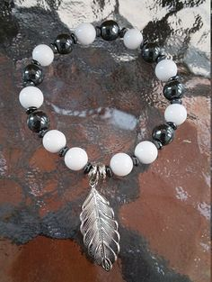 Check out this item in my Etsy shop https://www.etsy.com/listing/262337690/white-jade-hematite-leaf-bracelet