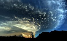 A cloud of ash from Puyehue volcano rises into the sky above Osorno in southern Chile, on June 5, 2011.