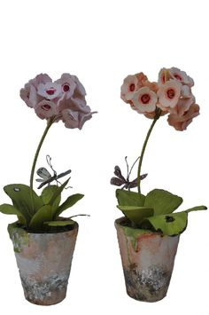 Hand Made Porcelain Flowers and container.  Tole leaves and butterfly. 7 1/2 x 6 1/2.