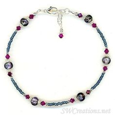 Handcrafted adjustable 9 1/4 - 9 3/4 inch beaded anklet created with matte dark blue seed beads, fuchsia Swarovski Austrian crystals, amethyst glass beads, bright Bali .925 silver, and sterling silver