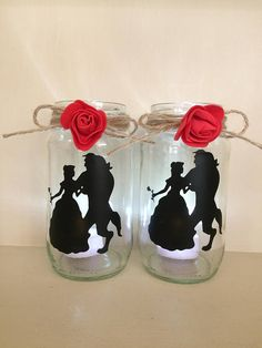 A medium size jar upcycled This is a beauty and the beast jar light lantern.  The character is belle and beast from beauty and the beast Disney inspired film they are Hand painted and sealed by my self Can do different designs or colours painted and sealed silhouette style tea light