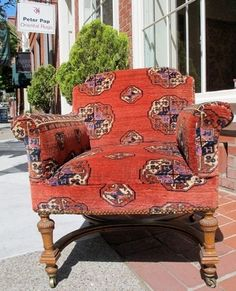 Chair upholstered with fragments from a Salor main carpet. Some of the inner portions are contiguous. The chair is probably late 19th century. The fragments are certainly earlier and were antique when  ...