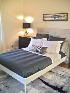 Modern bedding from @Au Lit Fine Linens  and carpet from @WSTUDIO Carpets #IncomeProperty