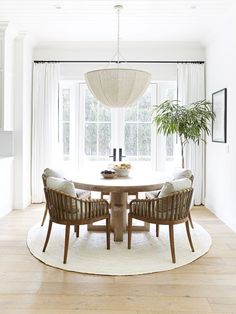 20 Modern Farmhouse Dining Rooms That Will Transport You To The Countryside From weathered wood tables to spindle-back chairs, nothing says home sweet home better than a farmhouse dining room. Here's how to get the look. Dining Nook, Dining Room Design, Kitchen Dining, Farmhouse Dining Chairs, Cozy Kitchen, Wicker Dining Room Chairs, Conservatory Dining Room, Carpet Dining Room, Round Kitchen