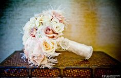 Feathered pastel bridal bouquet #lovely