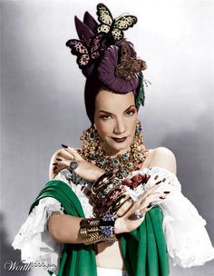 carmen miranda. Most known for being able to samba with her fruit basket, I love the chunky jewelry and the frilly sleeves.