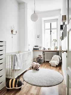Love this room! The round rug is perfect in this space.