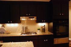 backsplash+ideas+for+dark+kitchen+cabinets | black cabinets and cream subway tile backsplash | Kitchen Ideas