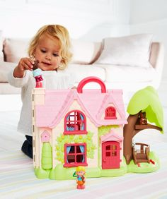 I'm shopping Happyland Cherry Lane Cottage in the Mothercare iPhone app.