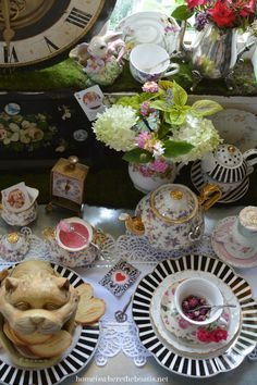 Clocks, teapots, playing cards, and Cheshire Cat server for Mad Tea Party!   homeiswheretheboatis.net #aliceinwonderland #pottingshed