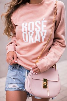 Check out The Darling Detail's pink Rosé Okay sweatshirt and destroyed denim shorts that go perfectly with her favorite South of France wine, rosé !