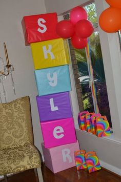 Rainbow party decorations at the entrance, like this blocks with the name of the celebrant on it.