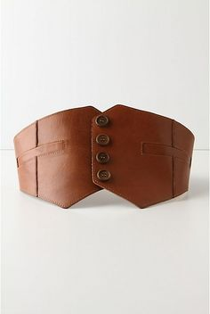 Three Piece Belt. Tailored leather belt, with a row of suiting inspired buttons. Elasticated back. http://images.anthropologie.com/is/image/Anthropologie/19107341_038_e?$redesign-zoom-5x$ http://images.anthropologie.com/is/image/Anthropologie/19325380_020_b1?$redesign-zoom-5x$ http://images.anthropologie.com/is/image/Anthropologie/19325380_020_c?$redesign-zoom-5x$