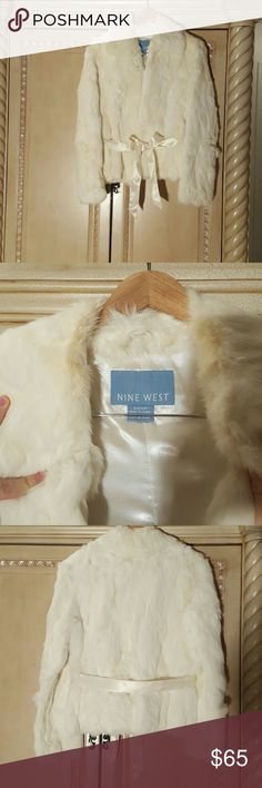 REAL Nine West Rabbit Fur coat . Worn 3 times Very good condition.  Has a little bit of discoloration  around the collar.  Over wise prefect condition. Very warm and soft.  We now live in Florida so I have no need for it. Nine West Jackets & Coats