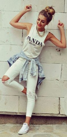 Wheretoget - White tank top with printed words, faded blue denim jacket, white skinny ripped jeans, white Converse sneakers, and gold chain necklace
