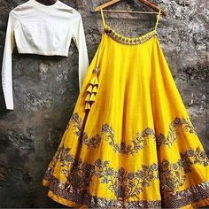 A beautiful lehenga with white top and yellow embroidered lehenga with golden borders. Made to perfect measurements and requirements. For further information on this beautiful piece or custom creating a piece through HD&GD email us at hdgd20@yahoo.com  #lehenga#anarkalilove#ootd#desiculture#hdgdstudio#desistyle#indianfashion#indianwedding#wedding2015#instafashion#fashionlove#hdgddesign#beautifulbride#instagram#weddingfever#desicouture#india