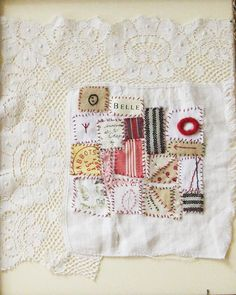Small art quilt on antique cloth Textile Tokens by ColetteCopeland