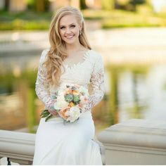Modest wedding dress with long lace sleeves from alta moda. -- Modest bridal gown