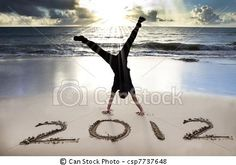 by tomwang (happy new year 2012 on the beach with sunrise)