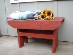 Build a cute bench made out of wood pallets!
