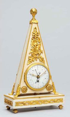 An unusual Directoire small white marble and ormolu obelisk mantel timepiece, with revolutionary and standard time indications La Coeur L'ainé, Paris. Circa 1795 The case with ball finial and with beaded mounts to the angles, on foliate-capped paw feet above a rectangular plinth with entwined laurel mounts to front and sides, on toupie feet.