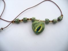 Heart and bead necklace  green necklace mock by LiloLilsEmporium