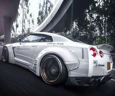 Design has just unveiled the very first Liberty Walk Nissan GT-R in Hong Kong, and it is just as ep. R35 Gtr, Nissan Gtr R35, Liberty Walk, Exotic Sports Cars, Tuner Cars, Car Engine, Nissan Skyline, Small Cars, Amazing Cars