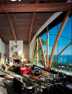 GoAltaCA   Another of Harry Gesner's designs perches atop Malibu cliffs with incredible views of the ocean, seen here through gigantic Gothic windows. - See more at: http://www.dwell.com/houses-we-love/article/7-stunning-homes-perched-high-above-pacific-ocean#4 #california #architecture #malibu