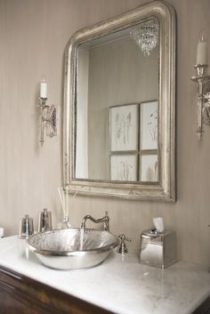Adding a silver faucet is a no-brainer, but a silver sink? So cool! More