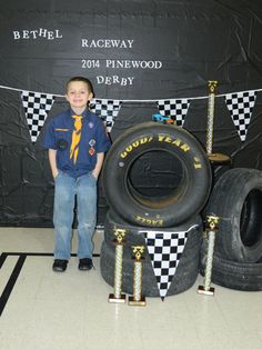 black tablecovers for background, tires and pennants make a great photo area