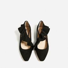 Black ruffle ballet flats: http://www.stylemepretty.com/living/2016/11/04/budget-savvy-finds-for-this-seasons-hottest-fashion-trends/