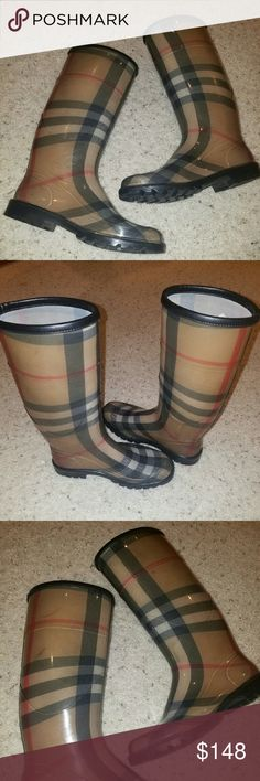 Burberry plaid rain boots Authentic burberry plaid rain boots. It has minor scuffing and stain but no major defect other than that good used condition. Burberry Shoes Winter & Rain Boots