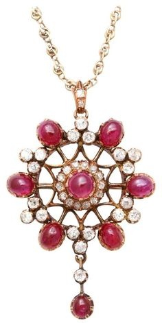 Victorian Cabochon Ruby & Old Mine Diamond Pendant Brooch. Set in 14kt Yellow Gold and suspended from a more modern filigree chain. Very sumptuous. Circa 1880