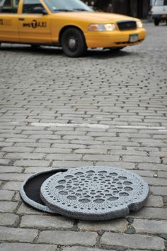 Crochet artist Nathan Vincent created this amazing replica of a classic New York City manhole cover