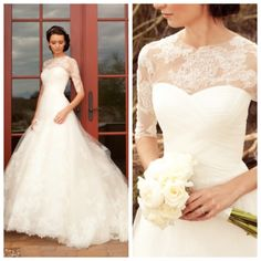 Beautiful wedding ballgown with sweetheart neckline and lace 1/2 sleeve upper. On just the right girl, GORGEOUS. (I'd love to see 3/4 sleeve though!)