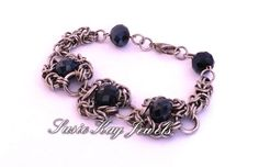 Check out this item in my Etsy shop https://www.etsy.com/listing/236997449/romanov-blue-faceted-bracelet