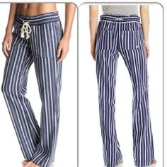 """Navy Striped Beach Pants These fabulous beach pants are super soft and comfortable woven fabric of 55% linen, and 45% viscose. Smocked waistband with functional drawstring cord. Front slant pockets, back patch pockets. Inseam 30"""" for all sizes. Available in S,M,L. Small(3/5) fits waist 26""""-27"""", hips 36""""-37"""". Medium(7/9) fits waist 28""""-29"""", hips 38""""-39"""". Large(11) fits waist 30"""", hips 40"""". Swim Coverups"""
