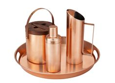 Copper ice bucket ($30), cocktail shaker ($15), pitcher ($20), and tray ($35)