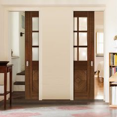 Deanta Unilateral Pocket Kensington Walnut Prefinished Door with Clear Bevelled Safety Glass.    #doors #unilateraldoors #door #moderndoor #interiordesign #moderninterior #eclisse #pocketdoors #hiddendoors