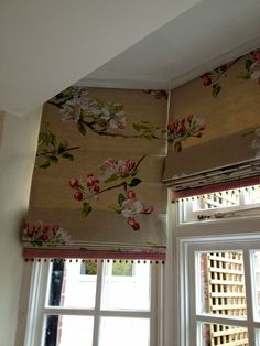 Roman blinds in a bay window - note the pattern matching!