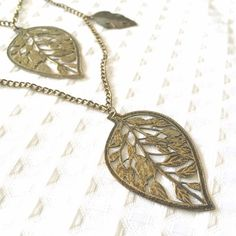 Layered Decorative Leaf Necklace This Layered Decorative Leaf Necklace is lightweight and fun. A good staple for your autumn wardrobe! Jewelry Necklaces