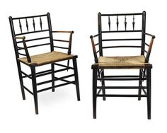 ATTRIBUTED TO PHILIP WEBB (1831-1915) FOR MORRIS & COMPANY  PAIR OF EBONISED 'SUSSEX' ARMCHAIRS, CIRCA 1880  each with spindle filled backs, above open armed and rush seats, raised on turned legs, linked by stretchers (2)   Estimate £400-600  Sold for £475 (buyer's premium included)