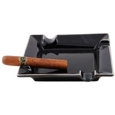 """Ashtray - CB Neptune . $13.59. Accomodates 54 ring gauge cigar. 8 1/4"""" x 8"""". Black square ashtray. A stylish black ashtray with contemporary silver edging. Four offsetting cigar rests accommodates a 54-ring cigar. 1"""" bowl. 8 1/4""""x8. Save 20% Off!"""